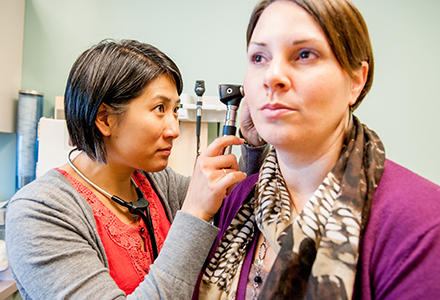 Vermont health professional with patient