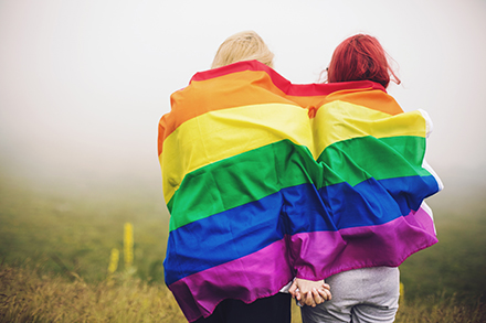 LGBT couple with rainbow flag