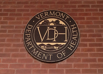 VT Health Department seal on building at 108 Cherry St., Burlington