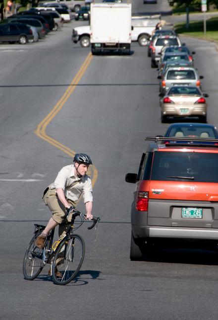 biker in Vermont traffic