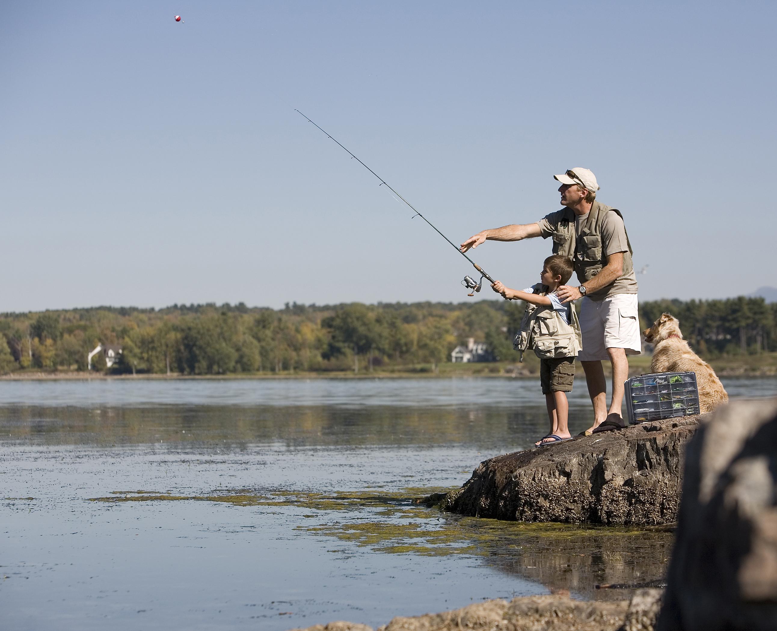dad and boy fishing