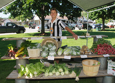 Farmers' Market stall with greens and radishes