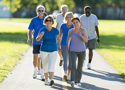 Group of adults power walking