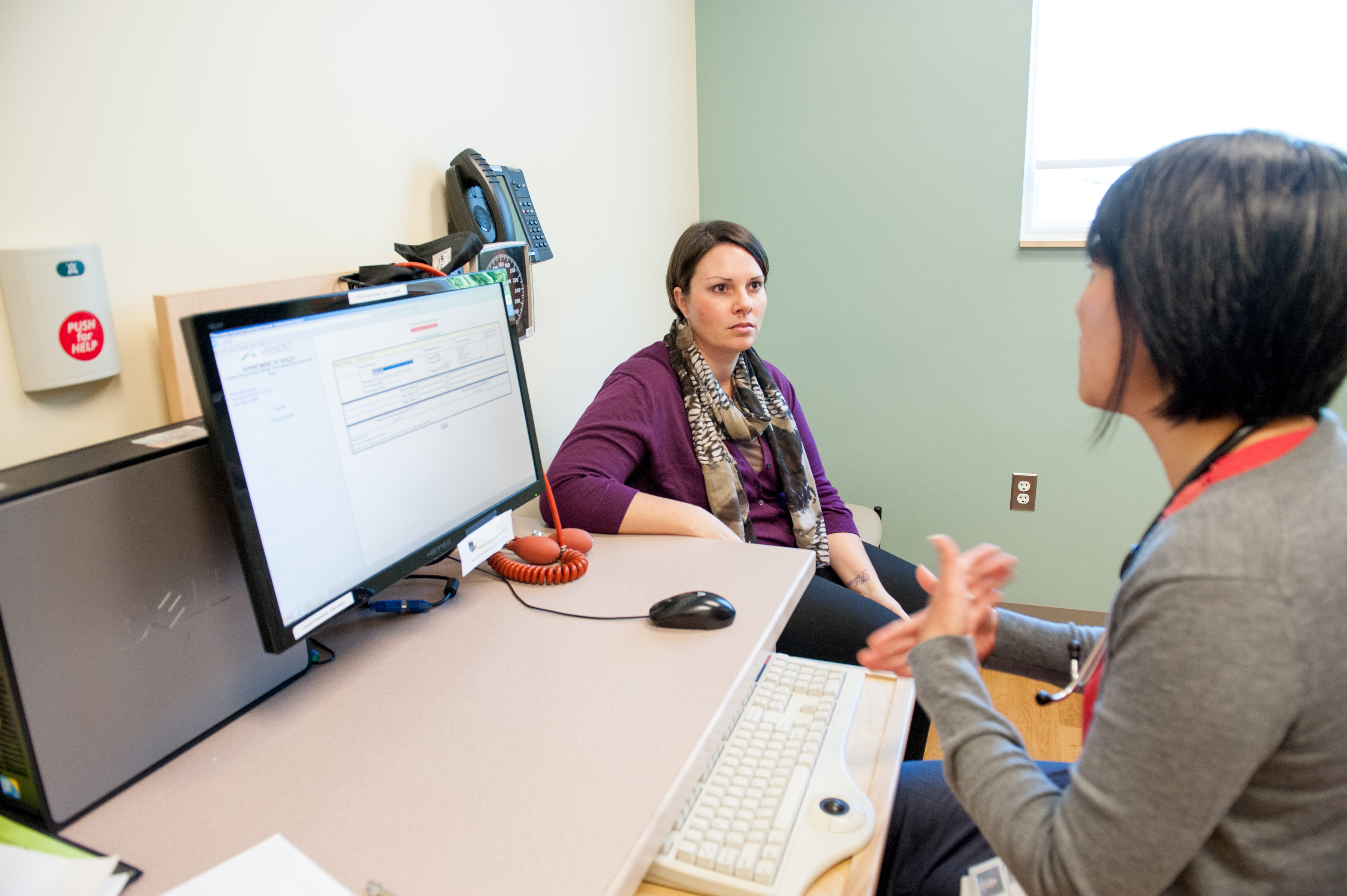 Health provider and patient at computer