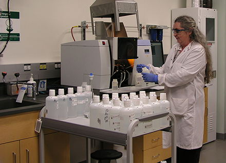 Lab staff doing test.