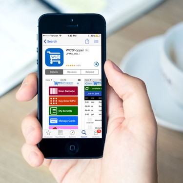 Shopper App phone in hand