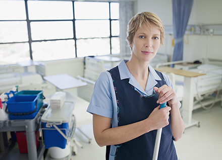Housekeeping staff cleaning hospital room.