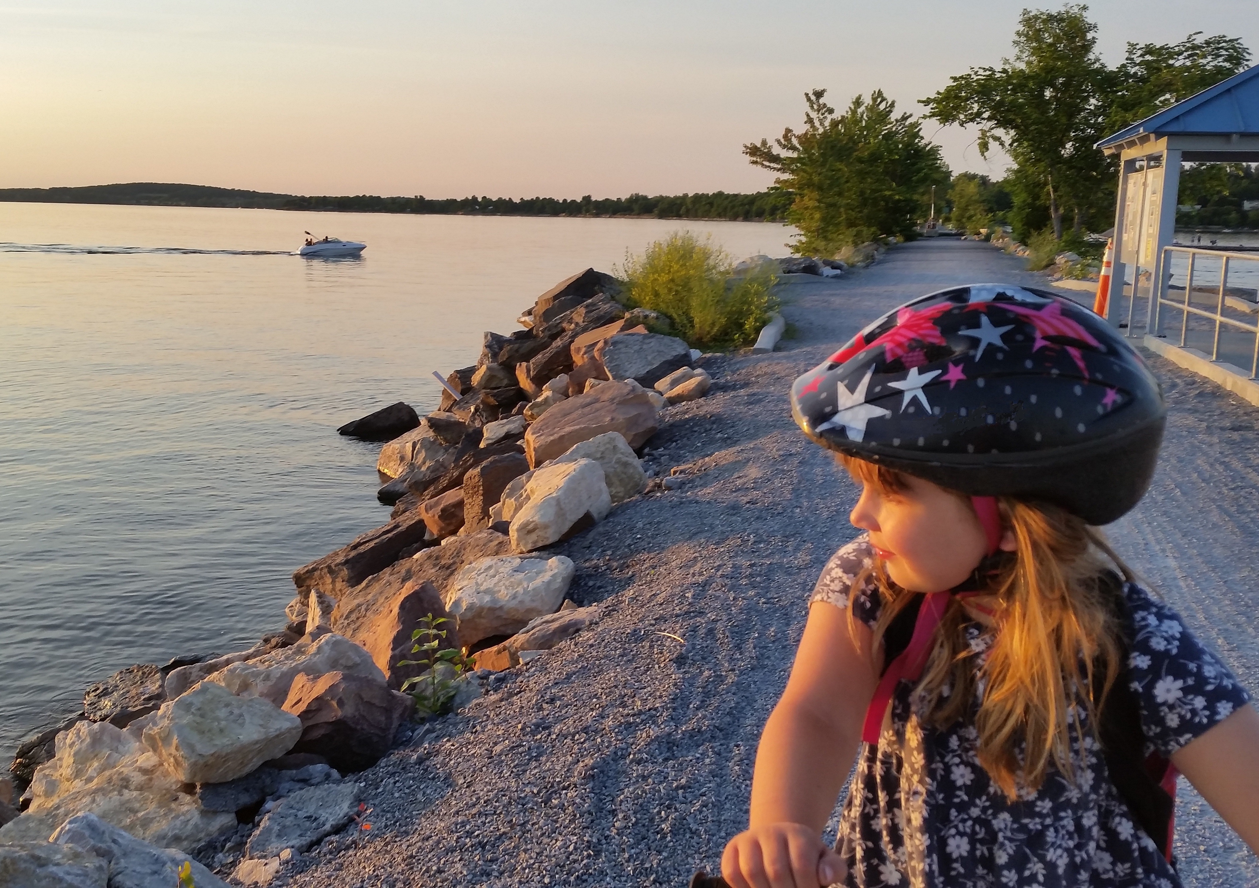 girl on bike near lake