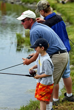 two men and boy fishing