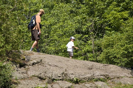 man and child hiking