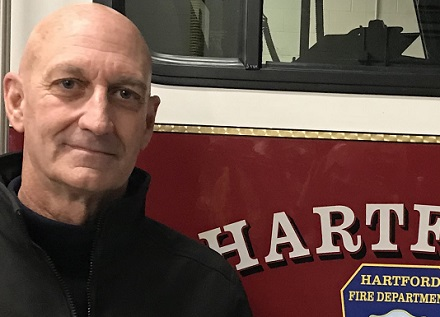 Town Health Officer for Hartford beside fire truck
