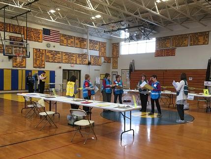 volunteers in school gym
