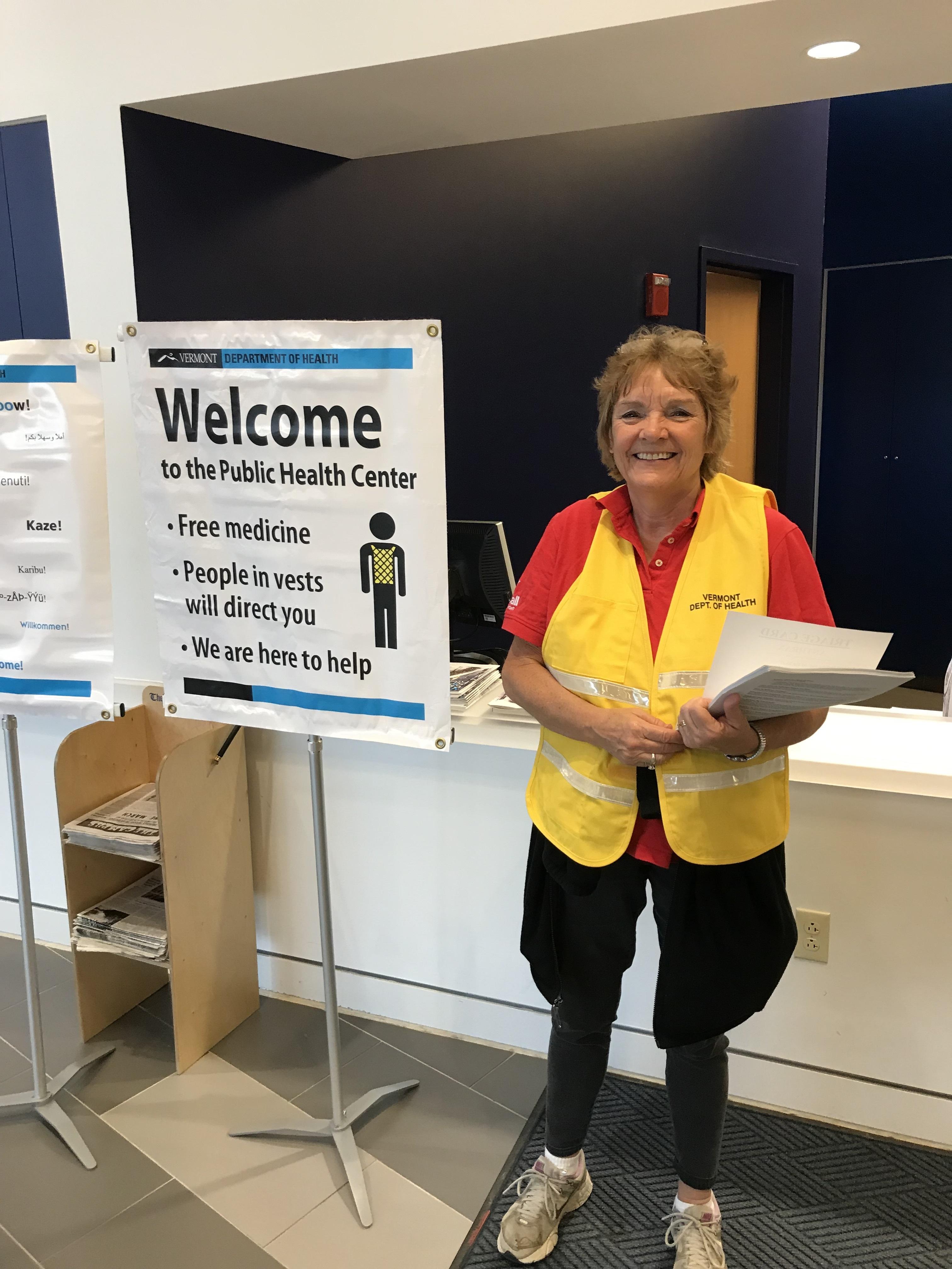 person in vest at public health center