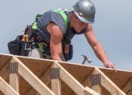 man building roof