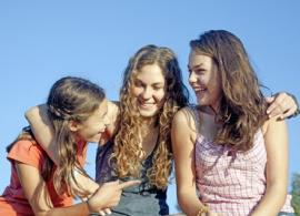 three teen girls smiling