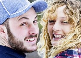 two young people, smiling