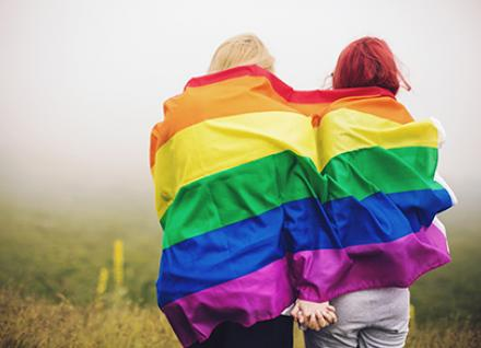 LGBT couple with rainbow flag