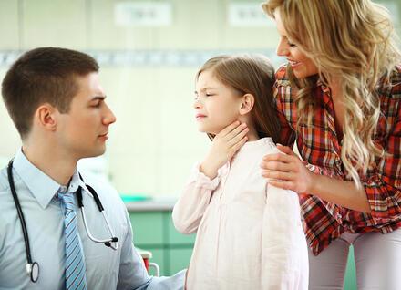 child holding throat