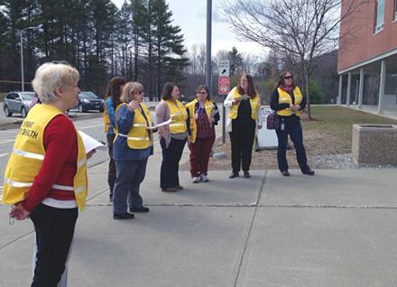 People outdoors wearing emergency vests