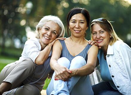 Three women sitting in a park