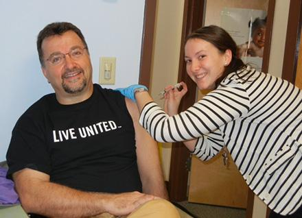 public health nurse giving Tdap vaccine at Vermont local health office