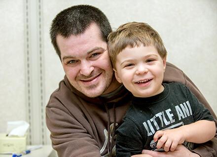 dad hugging son