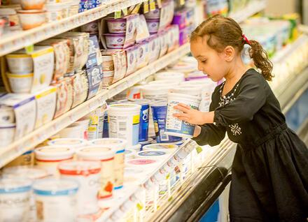 girl choosing yogurt