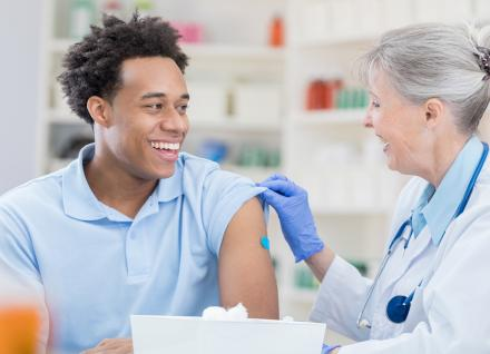 young man getting vaccination