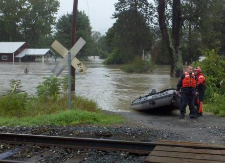 rescue personnel at flood scene