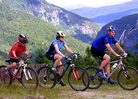 three people biking