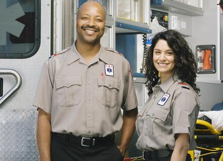 two paramedics outside ambulance
