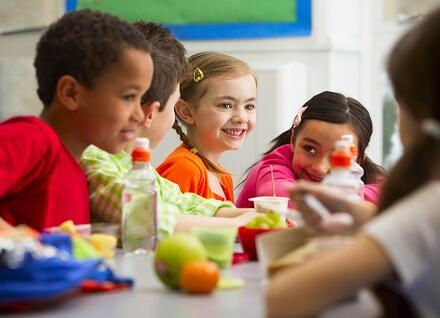 children enjoying lunch