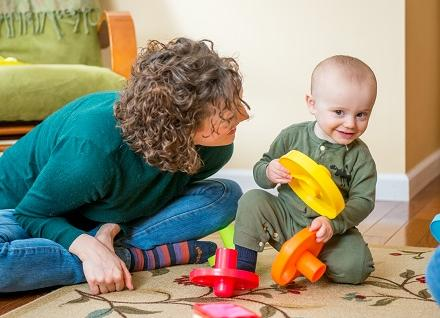 woman and toddler playing