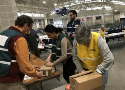 volunteers working at a distribution center
