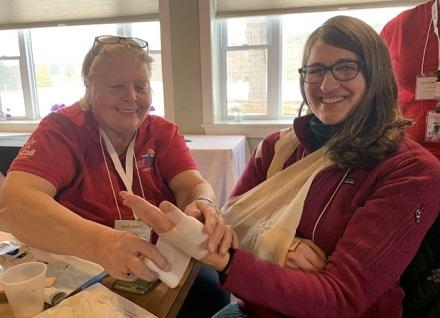 two people practicing bandaging