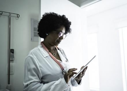 doctor looking at notes