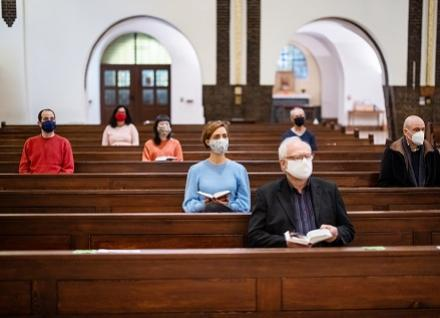 worshippers, distanced and masked
