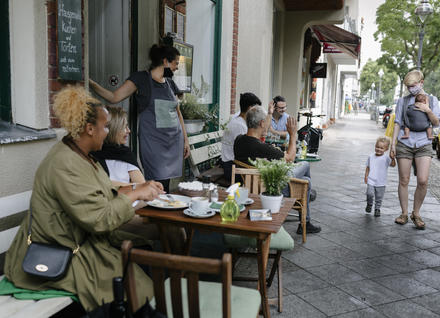 Diners at an outdoor cafe.