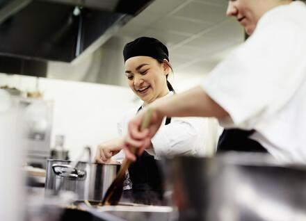 A cook in a restaurant kitchen