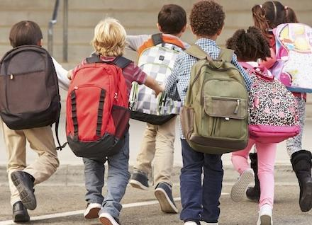 kids walking toward school's entrance