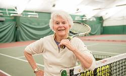 older Vermont woman at tennis court