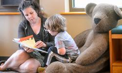 child care provider reading to child