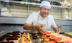 man baking cupcakes